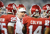 Jan. 1, 2011; Glendale, AZ, USA; Oklahoma Sooners head coach Bob Stoops talks to his players in the huddle against the Connecticut Huskies in the 2011 Fiesta Bowl at University of Phoenix Stadium. The Sooners defeated the Huskies 48-20. Mandatory Credit: Mark J. Rebilas-.