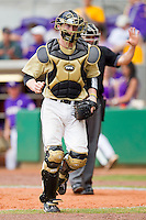 Catcher Brett Armour #6 of the Wake Forest Demon Deacons jogs off the field at the end of an inning against the LSU Tigers at Alex Box Stadium on February 20, 2011 in Baton Rouge, Louisiana.  The Tigers defeated the Demon Deacons 9-1.  Photo by Brian Westerholt / Four Seam Images