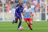 Bridgeview, IL - Saturday July 22, 2017: Chioma Ubogagu, Taylor Comeau during a regular season National Women's Soccer League (NWSL) match between the Chicago Red Stars and the Orlando Pride at Toyota Park. The Red Stars won 2-1.