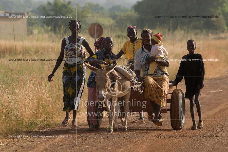 BURKINA FASO, people with donkey kart, the common transport in rural areas / Burkina Faso, Menschen mit Eselskarren