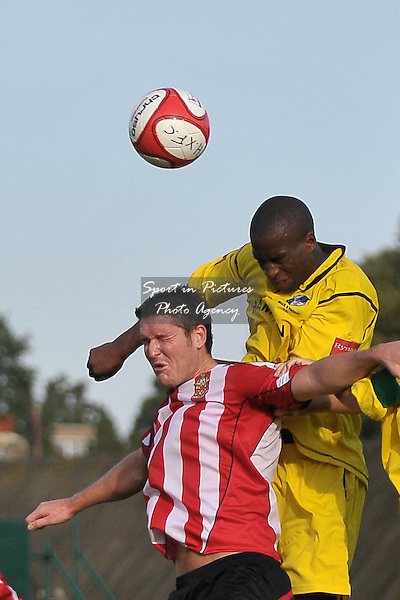Bobby Aisien (Wingate jumps higher than Frankie Curley (Hornchurch). AFC Hornchurch Vs Wingate and Finchley. Ryman Premier League. The Stadium. Essex. 01/10/2011. MANDATORY Credit Sportinpictures/Garry Bowden - NO UNAUTHORISED USE - 07837 394578