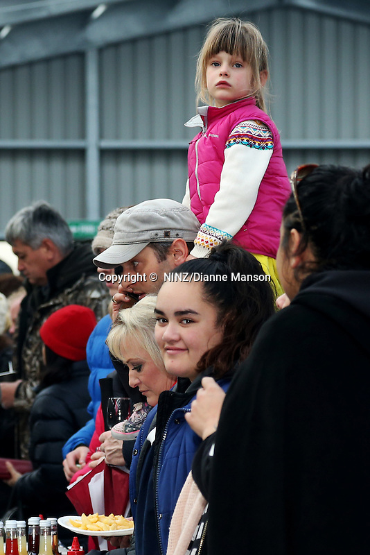 Members of the public stand in queue at the food stalls during the Bluff Oyster and Food Festival, Bluff, New Zealand, Saturday, May 21, 2016. Credit: Dianne Manson