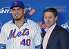 Wilson Ramos, newly-signed New York Mets catcher, and the organization's COO Jeff Wilpon pose for pictures during Ramos' introductory news conference at Citi Field in Flushing. NY on Tuesday, Dec. 18, 2018.