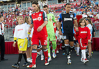 27 August 2011:Toronto FC midfielder Torsten Frings #22 and San Jose Earthquakes defender Ramiro Corrales #12 lead the teams onto the pitch during a game between the San Jose Earthquakes and Toronto FC at BMO Field in Toronto..The game ended in a 1-1 draw.