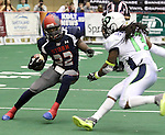 "SIOUX FALLS, SD - FEBRUARY 21:  Troy Harrison #22 from the Sioux Falls Storm looks for running room past Cornelius ""Pig"" Brown #13 from the Nebraska Danger in the first quarter of their game Friday night at the Sioux Falls Arena. (Photo by Dave Eggen/Inertia)"