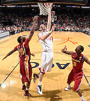 Dec. 30, 2010; Charlottesville, VA, USA; Virginia Cavaliers forward Will Regan (4) shoots the ball between Iowa State Cyclones forward Calvin Godfrey (15) and Iowa State Cyclones forward Melvin Ejim (3) during the game at the John Paul Jones Arena. Iowa State Cyclones won 60-47. Mandatory Credit: Andrew Shurtleff