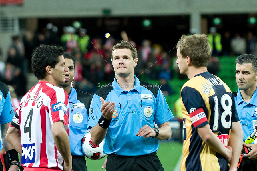 MELBOURNE, AUSTRALIA - AUGUST 5, 2010: The referee tosses the coin in Round 1 of the 2010 A-League between the Melbourne Heart and Central Coast Mariners at AAMI Park on August 5, 2010 in Melbourne, Australia. (Photo by Sydney Low / www.syd-low.com)