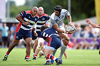Luke Charteris of Bath Rugby looks to offload the ball after being tackled. Pre-season friendly match, between Bristol Rugby and Bath Rugby on August 12, 2017 at the Cribbs Causeway Ground in Bristol, England. Photo by: Patrick Khachfe / Onside Images