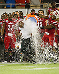 Louisville Cardinals head coach Charlie Strong was drenched with water as the Louisville Cardinals defeated the Miami Hurricanes 36-9 in the Russell Athletic Bowl in Orlando, Fl. on December 28, 2013.  Photo by Mark Mahan
