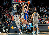 WASHINGTON, DC - DECEMBER 28: Mac McClung #2 of Georgetown blocks a shot by Mark Gasperini #23 of American. during a game between American University and Georgetown University at Capital One Arena on December 28, 2019 in Washington, DC.