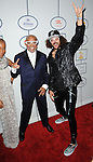 Berry Gordy and Red Foo arriving at the Clive Davis 2014 Pre-Grammy Gala, held at The Beverly Hilton Hotel on January 25, 2014.