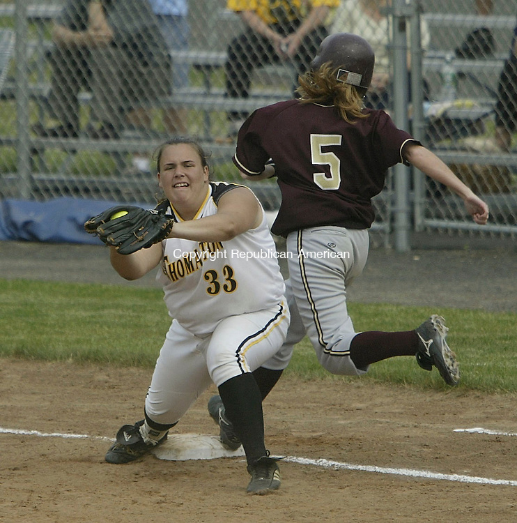 WEST HAVEN, CT - 06 June 2005 -060605BZ04- Sacred Heart #5, Krista Petitti stretches for the bag as Thomaston #33, Morgan Luschenat makes the out during the Class S semifinal at West Haven Monday afternoon. <br /> Jamison C. Bazinet Photo