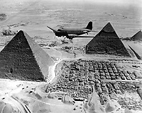 An Air Transport Command plane flies over the pyramids in Egypt.  Loaded with urgent war supplies and materials, this plane is one of a fleet flying shipments from the U.S. across the Atlantic and the continent of Africa to strategic battle zones.  1943. (Army)<br /> Exact Date Shot Unknown<br /> NARA FILE #:  111-SC-179564<br /> WAR &amp; CONFLICT BOOK #:  1015