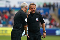 (L-R) Assistant referee John Flynn speaks to referee Oliver Langford during the Sky Bet Championship match between Swansea City and Ipswich Town at the Liberty Stadium, Swansea, Wales, UK. Saturday 06 October 2018