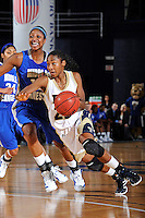 12 January 2012:  FIU guard Jerica Coley (22) drives to the basket around Middle Tennessee State guard-forward Icelyn Elie (13) in the second half as the Middle Tennessee State University Blue Raiders defeated the FIU Golden Panthers, 74-60, at the U.S. Century Bank Arena in Miami, Florida.