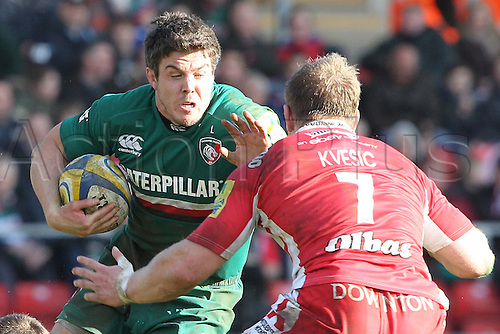 16.02.2014 Leicester, England. Leicesters Anthony Allen is confronted by Gloucesters Matt Kvesic during the Aviva Premiership game between Leicester Tigers and Gloucester Rugby from Welford Road Stadium.