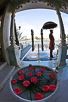 Silhouette of doorman in traditional costume with parasol at the Taj Lake Palace. (Photo by Matt Considine - Images of Asia Collection)