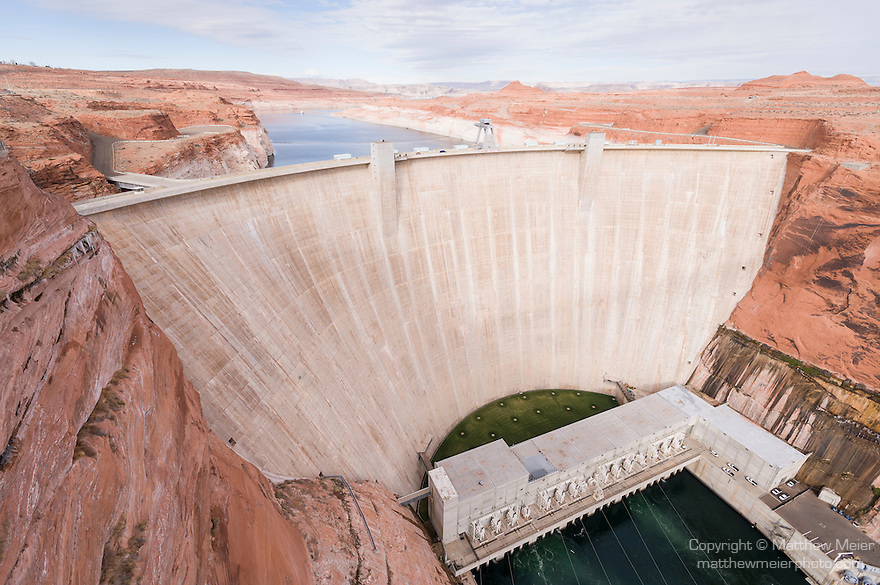 Glen Canyon Dam, Page, Arizona; Glen Canyon Dam and Powerplant, as viewed from the Glen Canyon Dam bridge, with Lake Powell in the background