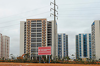 ANGOLA Luanda, the capital is one of the expensive real estate markets worldwide, Kilamba town, construction site of new building blocks by chinese construction companies like chinese state owned CITIC  financed by loans from Hongkong based CIF China International fund, which Angola is paying back with crude oil supply to China / ANGOLA Luanda, die Hauptstadt ist einer der teuersten Immobilienplaetze weltweit, Kilamba Stadt, Bau neuer Wohnblocks am Stadtrand von chinesischen Firmen wie der staatlichen chinesischen Firma CITIC finanziert durch Kredite von CIF China International Fund, die Kredite zahlt Angola durch Erdoel Lieferungen an China zurueck