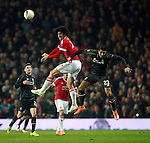 Marouane Fellaini of Manchester United wins a header over Emre Can of Liverpool during the UEFA Europa League match at Old Trafford. Photo credit should read: Philip Oldham/Sportimage