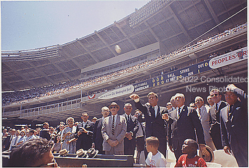 United States President John F. Kennedy attends the 32nd All-Star Baseball Game at D.C. Stadium and throws out the first ball on July 10, 1962.  Pictured VIPs include: Speaker of the U.S. House John W. McCormack (Democrat of Massachusetts), Dave Powers, Vice President Lyndon B. Johnson, President Kennedy, Commisioner of Baseball Ford. C. Frick, Lawrence O'Brien, others (in foreground- Dennis Marcel, Frank Brown, members of the Washington Boys Club ).Mandatory Credit: Cecil Stoughton / The White House via CNP