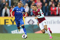 Burnley's Dwight McNeil looks to get away from Everton's Richarlison<br /> <br /> Photographer Rich Linley/CameraSport<br /> <br /> The Premier League - Burnley v Everton - Saturday 5th October 2019 - Turf Moor - Burnley<br /> <br /> World Copyright © 2019 CameraSport. All rights reserved. 43 Linden Ave. Countesthorpe. Leicester. England. LE8 5PG - Tel: +44 (0) 116 277 4147 - admin@camerasport.com - www.camerasport.com