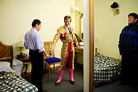 Puebla, Mexico - DEC 5: Spain's Julio Benitez, 23, a matador from Cordoba--like his father--gets ready for a night of work at the Plaza del Toros with his sideman, Raul Bacelis, left, and a co-manager, right, inside a hotel rooom on Friday December 5, 2008, in Puebla, Mexico. (Photo by Landon Nordeman)