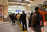 March 17, 2011, Tokyo, Japan - A long line is seen at the JR Highway Bus Ticket Office inside Tokyo Station as many people fear the high radiation levels that drifted to Tokyo from the quake-hit nuclear plant in Fukushima. The radiation fears has caused many people to flee from the city to the southern regions of Japan and overseas. (Photo by Christopher Jue/AFLO) [2331]