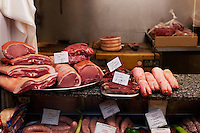 Pork products for sale at a traditional butcher's shop in the Oxford Covered Market.