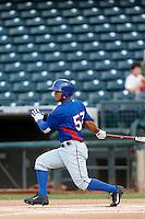 Eduardo Pinto #57 of the AZL Rangers bats against the AZL Royals at Surprise Stadium on July 15, 2013 in Surprise, Arizona. AZL Rangers defeated the AZL Royals, 3-2. (Larry Goren/Four Seam Images)