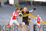 Dr Crokes Brian McMahon tries to stop Rathmore's Brendan O'Keeffe during the O'Donoghue Cup final in Fitzgerald Stadium on Sunday
