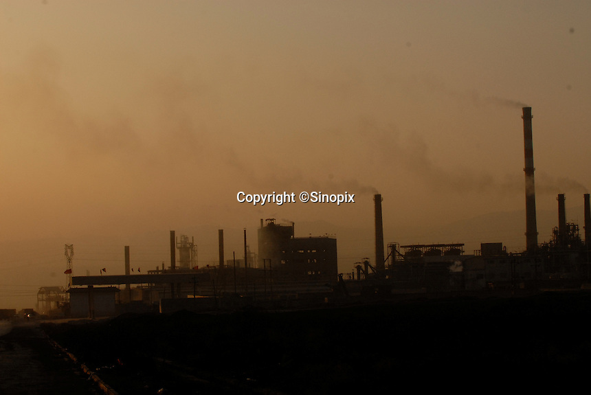 The Rui De coking and Chemical Co. Ltd. spews carbon monoxide and sulphur dioxide at Zhoacheng Town, Linfen, Shanxi Province, China. China produces around 2.4 billion tones of coal annually that contributes to more than 400,000 premature deaths annually due to air pollution, acid rain and poisonous ground water. Linfen is reportedly the most polluted city in China...PHOTO BY SINOPIX