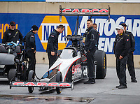 Oct 1, 2016; Mohnton, PA, USA; Crew member with NHRA top fuel driver Steve Torrence during qualifying for the Dodge Nationals at Maple Grove Raceway. Mandatory Credit: Mark J. Rebilas-USA TODAY Sports