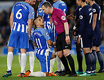 Referee Kevin friend has words with Anthony Kockaert of Brighton as he kneels down in a defensive wall during the premier league match at the Amex Stadium, London. Picture date 17th April 2018. Picture credit should read: David Klein/Sportimage