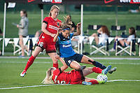 Kansas City, Mo. - Saturday April 23, 2016: FC Kansas City forward Shea Groom (2) and Portland Thorns FC defender Emily Sonnett (16) and defender Kat Williamson (5). FC Kansas City hosts Portland Thorns FC at Swope Soccer Village.