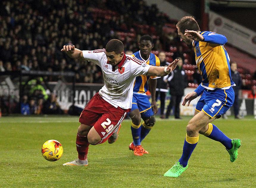 Sheffield United's Che Adams under pressure from Shrewsbury Town's Liam Lawrence<br /> <br /> Photographer Rich Linley/CameraSport<br /> <br /> Football - The Football League Sky Bet League One - Sheffield United v Shrewsbury Town - Tuesday 24th November 2015 - Bramall Lane - Sheffield<br /> <br /> &copy; CameraSport - 43 Linden Ave. Countesthorpe. Leicester. England. LE8 5PG - Tel: +44 (0) 116 277 4147 - admin@camerasport.com - www.camerasport.com