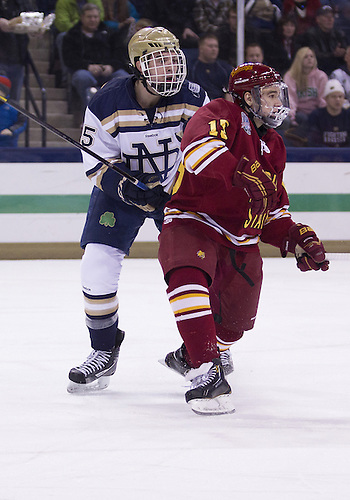 January 25, 2013:  Ferris State forward Nate Milam (15) and Notre Dame defenseman Kevin Lind (25) battle for position during NCAA Hockey game action between the Notre Dame Fighting Irish and the Ferris State Bulldogs at Compton Family Ice Arena in South Bend, Indiana.  Ferris State defeated Notre Dame 3-1.