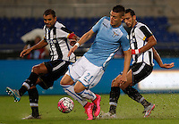 Calcio, Serie A: Lazio vs Udinese. Roma, stadio Olimpico, 13 settembre 2015.<br /> Lazio&rsquo;s Sergej Milinkovic-Savic, center, is challenged by Udinese's Danilo Larangeira, left, and Ali Adnan, during the Italian Serie A football match between Lazio and Udinese at Rome's Olympic stadium, 13 September 2015.<br /> UPDATE IMAGES PRESS/Isabella Bonotto