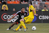 D.C. United midfielder Nick DeLeon (18) goes against Columbus Crew defender Josh Willimas (3)  D.C. United defeated The Columbus Crew 1-0 at RFK Stadium, Saturday August 4, 2012.