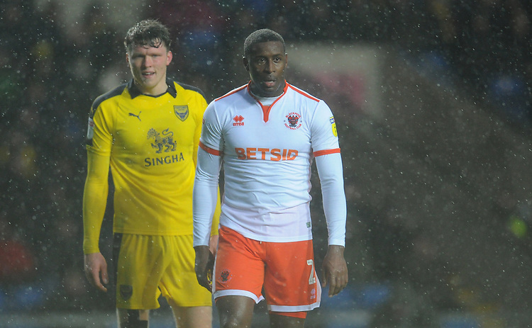 Blackpool's Donervon Daniels (right) and Oxford United's Rob Dickie<br /> <br /> Photographer Kevin Barnes/CameraSport<br /> <br /> The EFL Sky Bet League One - Oxford United v Blackpool - Saturday 15th December 2018 - Kassam Stadium - Oxford<br /> <br /> World Copyright © 2018 CameraSport. All rights reserved. 43 Linden Ave. Countesthorpe. Leicester. England. LE8 5PG - Tel: +44 (0) 116 277 4147 - admin@camerasport.com - www.camerasport.com