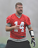 Ryan Fitzpatrick #14 New York Jets quarterback stretches during practice at the Atlantic Health Jets Training Jets Training Center in Florham Park, NJ on Wednesday, Dec. 30, 2015.