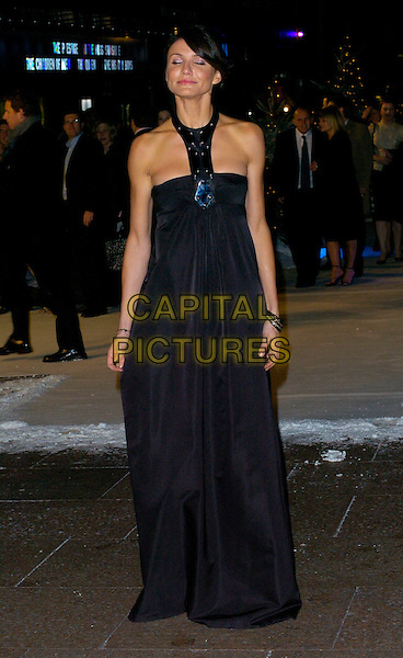 "CAMERON DIAZ .At the UK Film Premiere of ""The Holiday"", Odeon Leicester Square, London, UK..December 5th 2006.full length long black halterneck dress eyes closed.CAP/CAN.©Can Nguyen/Capital Pictures"