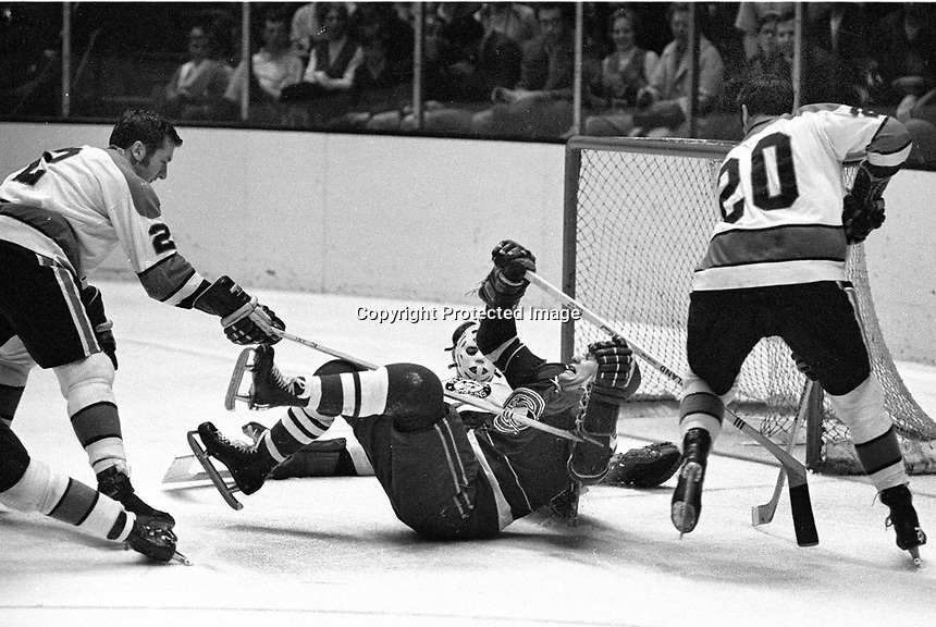 Seals Mike Laughton is upended by Pittsburg Penguins Greg Polis and Dean Prentice, goalie Al Smith.(1970 photo/Ron Riesterer)