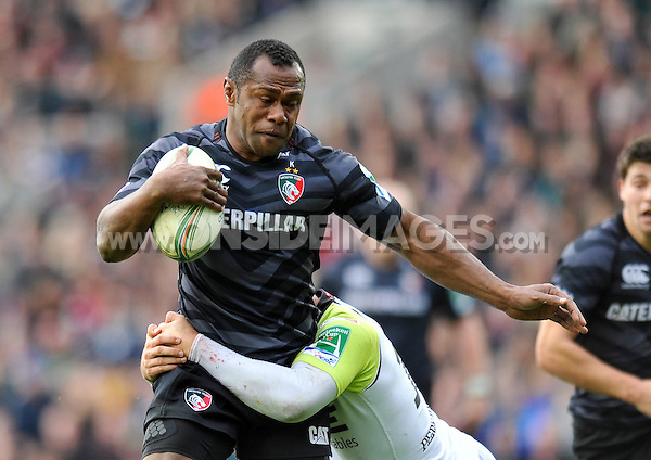 Vereniki Goneva is tackled in possession. Heineken Cup match, between Leicester Tigers and the Ospreys on October 21, 2012 at Welford Road in Leicester, England. Photo by: Patrick Khachfe / Onside Images