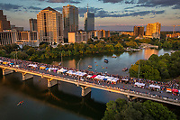 Thousands gather on the Congress Avenue Bridge for Bat Fest, Austin's most popular celebration held every August featuring 1.5 million Mexican free-tailed bats emerging from under the Congress Avenue Bridge at dusk, three stages with live music, more than 75 arts & crafts vendors, delicious food and drinks, fun children's activities, a bat costume contest and other bat activities.
