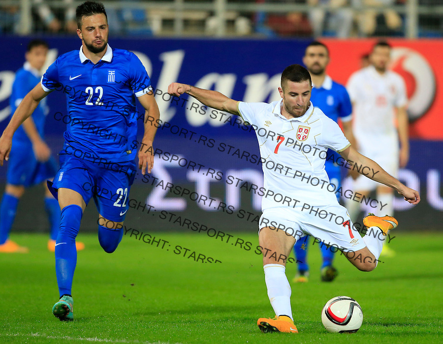 Fudbal<br /> Prijateljski mec-Friendly match<br /> Srbija v Grcka<br /> Zoran Tosic (R) and Andreas Samaris<br /> Chania, 18.11.2014.<br /> foto: Srdjan Stevanovic/Starsportphoto &copy;