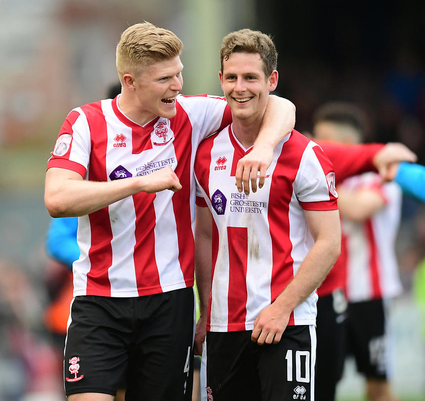 Lincoln City's Elliott Whitehouse, left, and Adam Marriott at the end of the game<br /> <br /> Photographer Chris Vaughan/CameraSport<br /> <br /> Vanarama National League - Lincoln City v Torquay United - Friday 14th April 2016  - Sincil Bank - Lincoln<br /> <br /> World Copyright &copy; 2017 CameraSport. All rights reserved. 43 Linden Ave. Countesthorpe. Leicester. England. LE8 5PG - Tel: +44 (0) 116 277 4147 - admin@camerasport.com - www.camerasport.com