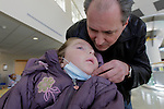 Immediately after learning that his daughter Sandra Massart had accepted his stem cells, William Massart whispers to Sandra, 10, at Duke University Hospital in Durham, NC, USA, on Tuesday, Feb. 14, 2012.  Sandra Massart is being treated for MLD, a degenerative condition.  Photo by Ted Richardson