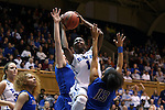 24 March 2014: Duke's Elizabeth Williams (1) shoots a layup while being defended by DePaul's Chanise Jenkins (13) and Megan Podkowa (behind). The Duke University Blue Devils played the DePaul University Blue Demons in an NCAA Division I Women's Basketball Tournament Second Round game at Cameron Indoor Stadium in Durham, North Carolina.