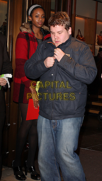 JAMES CORDEN .Designed by Mulberry...Made for Apple - Private View, .held at the Mulberry store, New Bond Street, London, England, UK,.November 5th 2009.half length jacket jeans grey gray coat .CAP/ROS.©Steve Ross/Capital Pictures